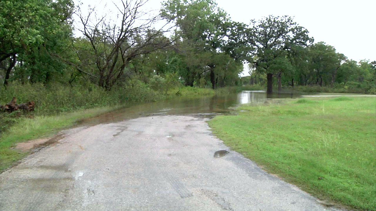 An example of a flooded road in Marshall County. (KTEN)