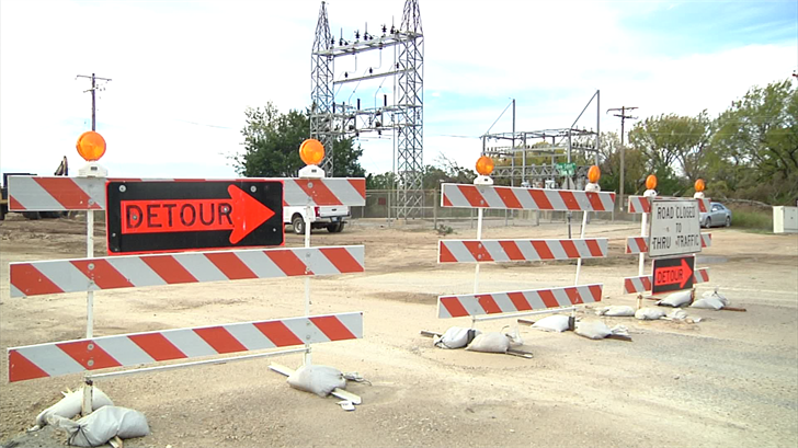 Roadblocks are set up at the Enos Road construction site, telling residents to take a slight detour (KTEN)