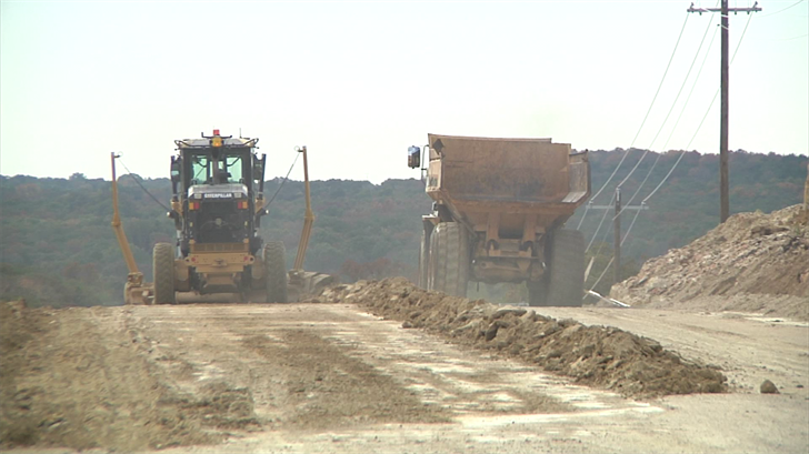 Construction workers lay out the roadwork on Enos Road. (KTEN)