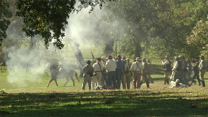 Gunfire is traded between actors portraying Union and Confederate soldiers. (KTEN)