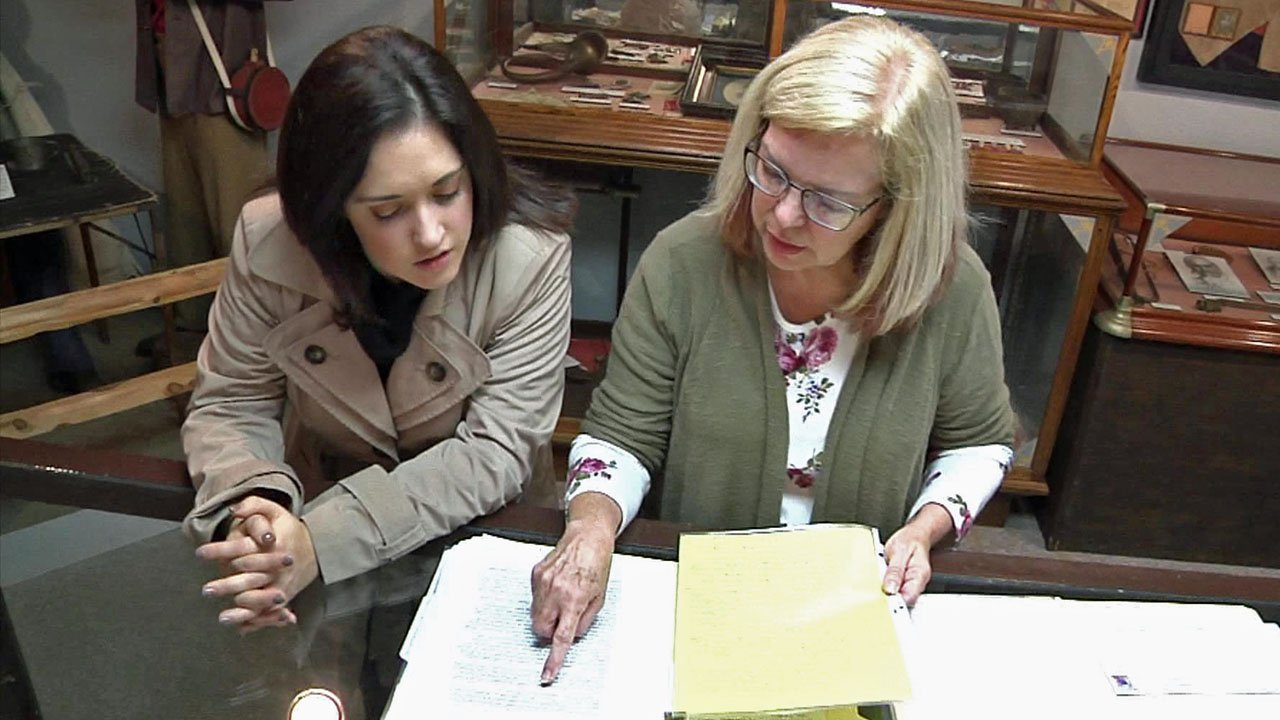 "Atoka County Museum director Cindy Wallis, right, reviews her correspondence with James ""Whitey"" Bulger. (KTEN)"