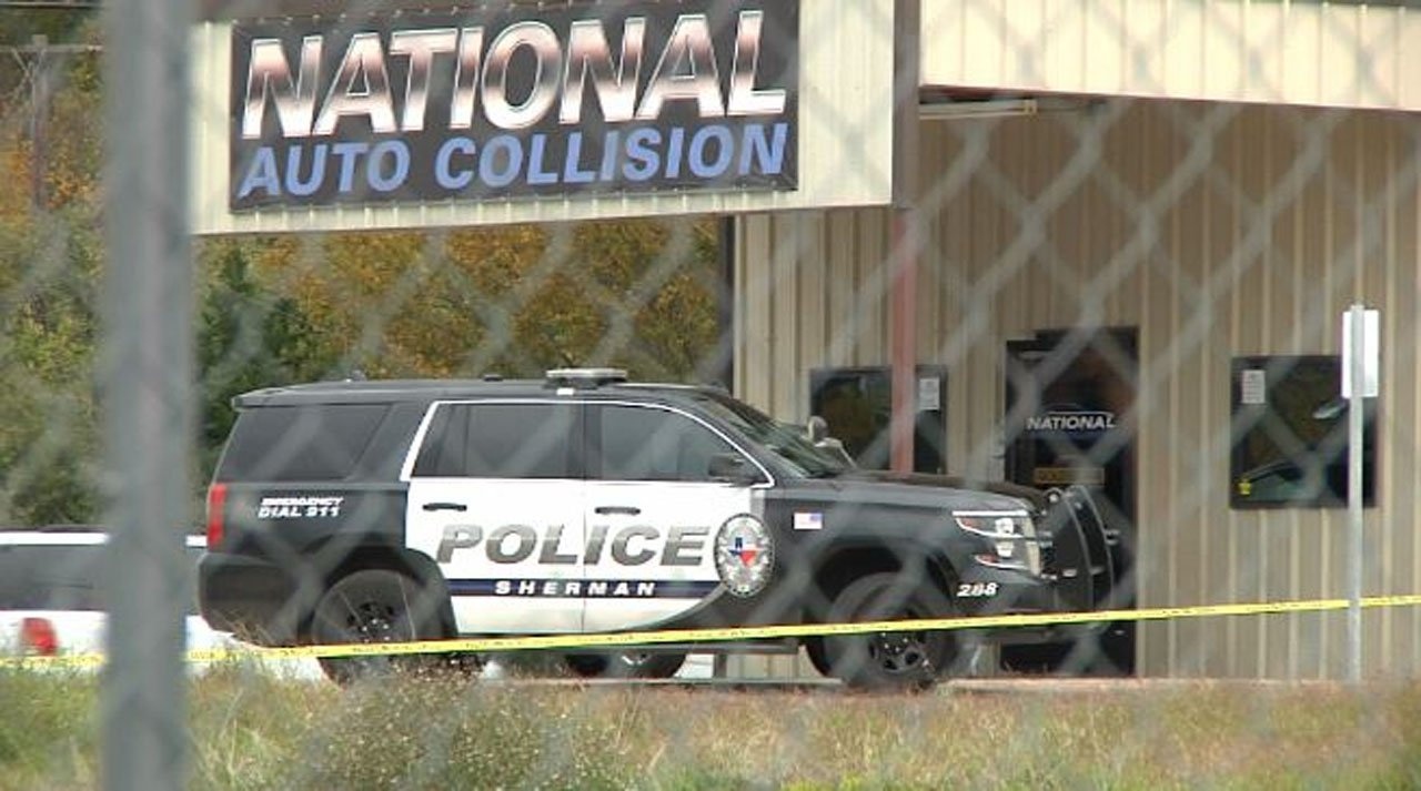 Sherman police investigate a shooting at National Auto Collision on November 8, 2018. (KTEN)