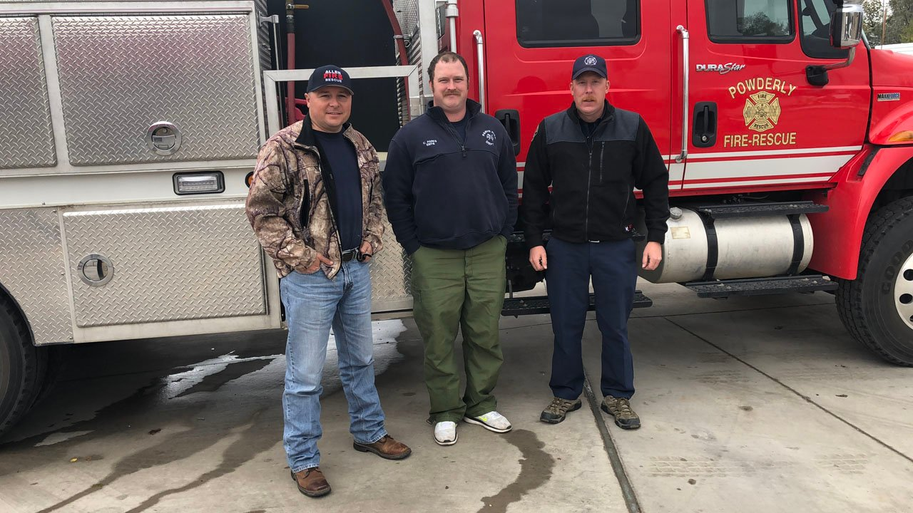North Texas firefighters (l-r) Michael Fox, Corey Parks and Matthew Barbee in Childress, Texas, on their way to California. (Courtesy Paris FD)