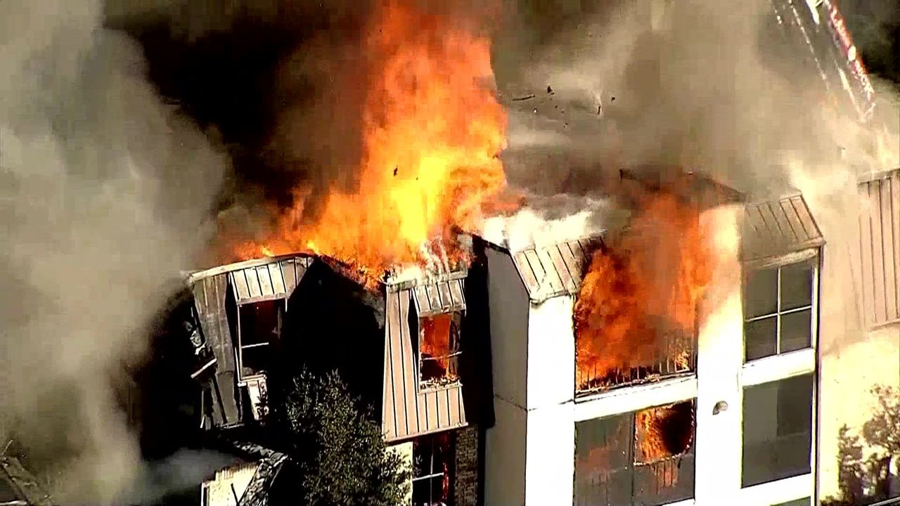 A three-story apartment building burned in Dallas on November 27, 2018. (KXAS via NBC News)