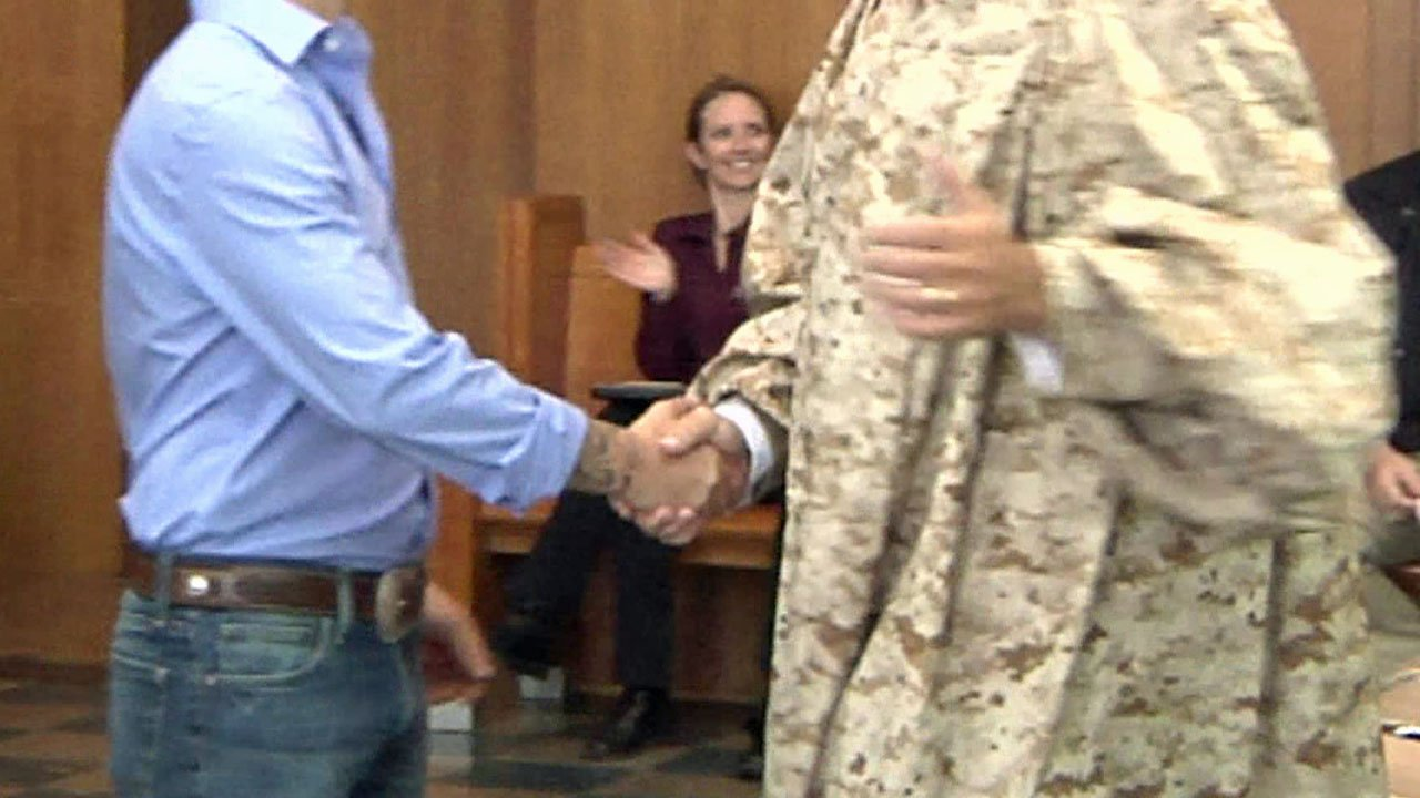 A graduate of the VALOR program is congratulated by Judge John Roach. (KTEN)