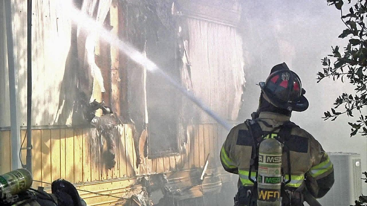 Firefighters battled a blaze at a mobile home in Collinsville on December 3, 2018. (KTEN)