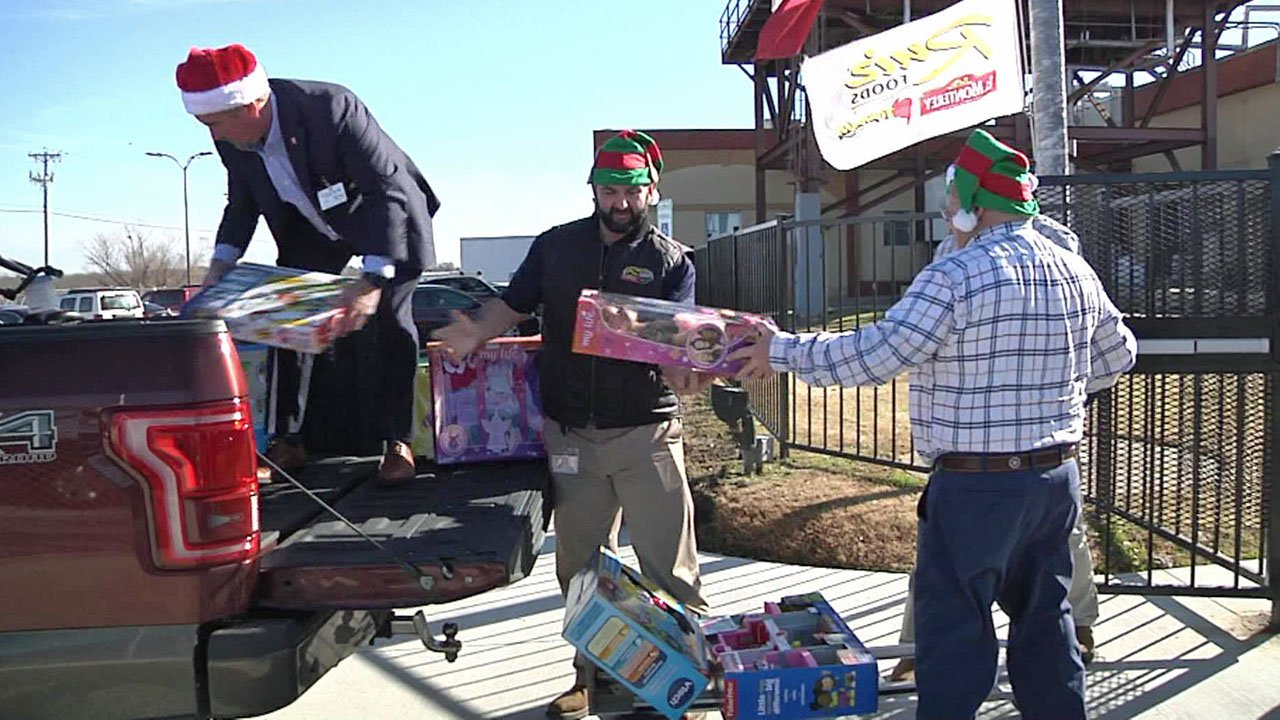 Ruiz Foods employees load toys collected for foster kids. (KTEN)
