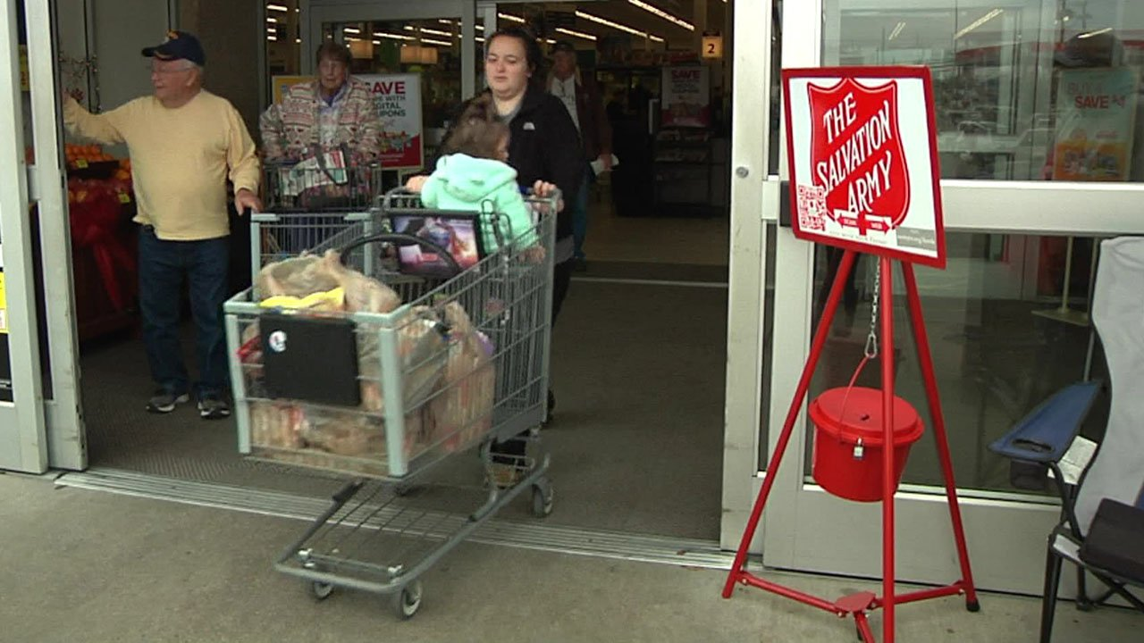 Shoppers in Sherman pass a Salvation Army collection point. (KTEN)