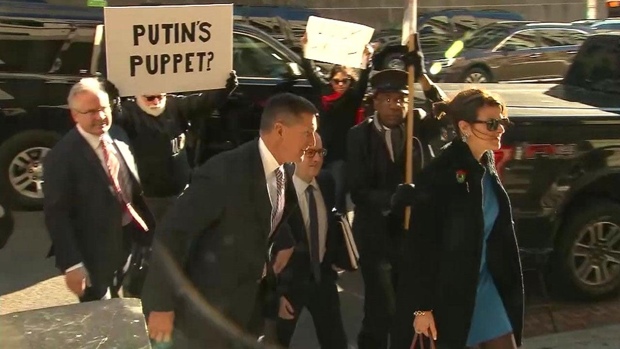 Michael Flynn, center left, arrives for sentencing on December 18, 2018. (CNN)
