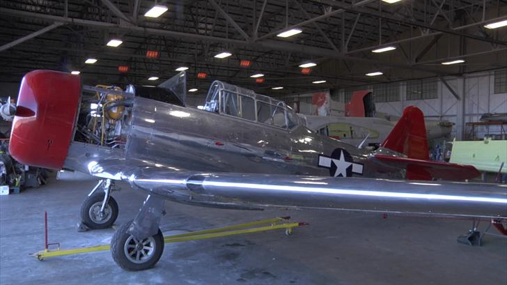 Historic planes are held inside of the Cavanaugh Flight Museum's hangar for restoration (KTEN)
