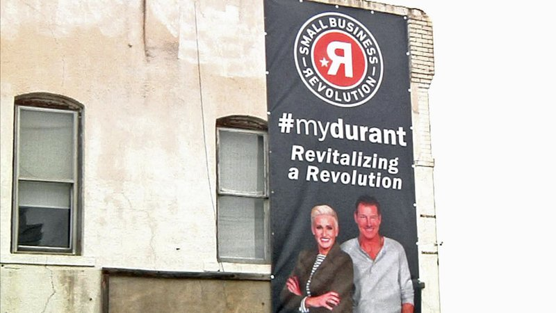Signs in Durant welcome the hosts of the Small Business Revolution TV reality show. (KTEN)
