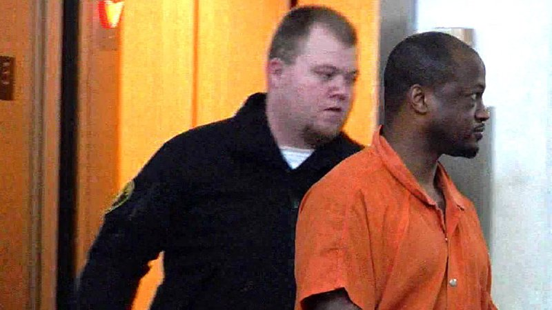 Accused killer Carlton Franklin, right, is escorted into a Carter County courtroom on January 11, 2019. (KTEN)