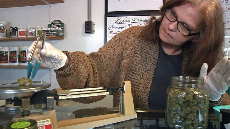 Medical marijuana dispenser Adelia White opposed adding regulations to the state's existing laws. (KTEN)
