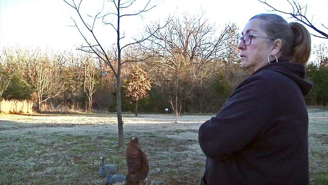 Judy Stephens worries about leaving her pet dog outside alone after observing coyotes in her Bryan County neighborhood. (KTEN)