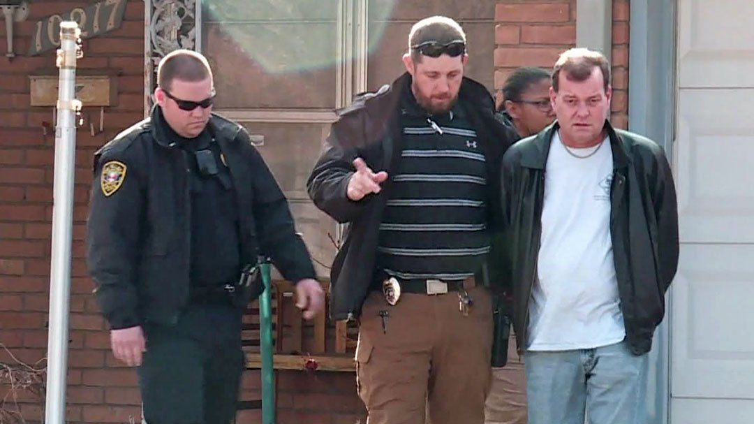 Lynn Little, right, is arrested at his home in The Village, Oklahoma. (KFOR via CNN)