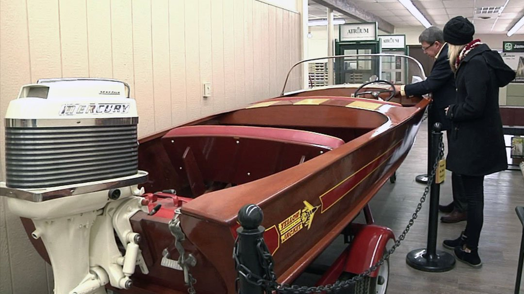 David Kanally shows off a restored Yellow Jacket boat to KTEN reporter Emily Akins. (KTEN)