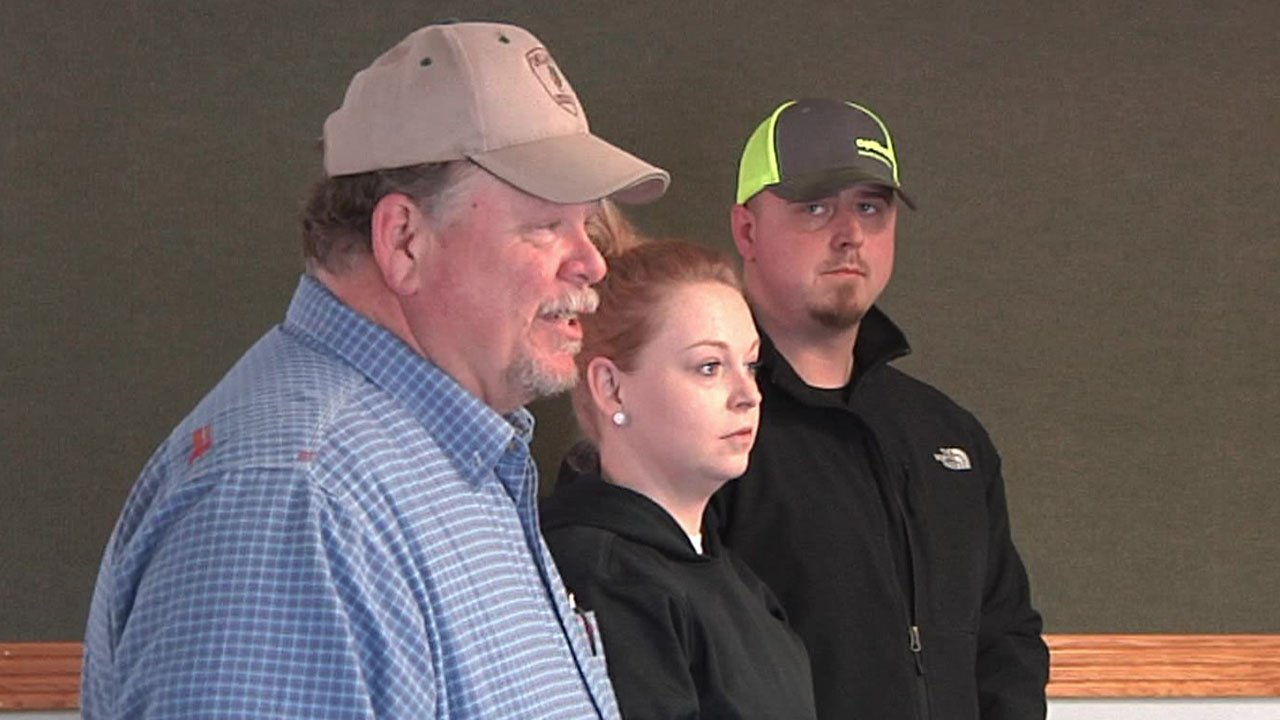 David Lansdale, left, presents awards to three Garvin County public safety employees in memory of his late wife. (KTEN)