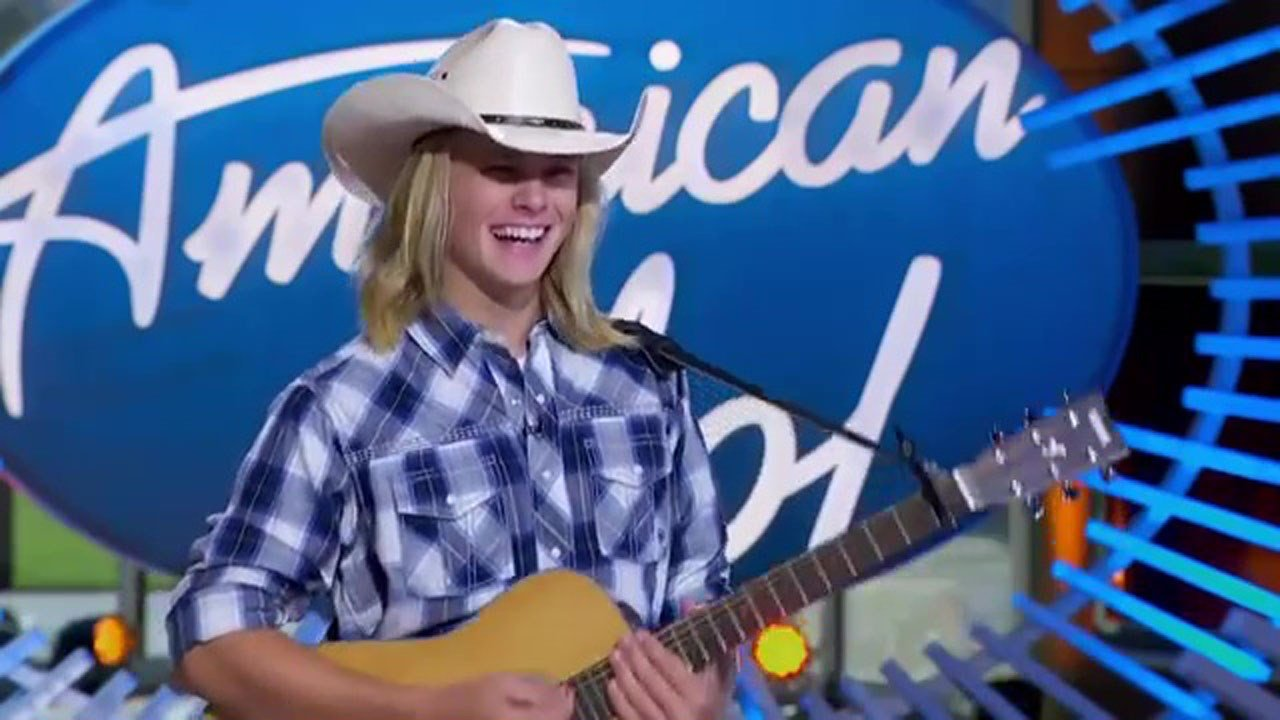 Austin Michael Robinson performs before the American Idol judges. (ABC)