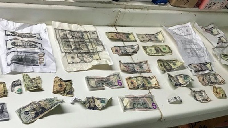 Counterfeit cash of various denominations was seized in a Whitesboro raid on March 14, 2019. (Grayson County Sheriff's Office)