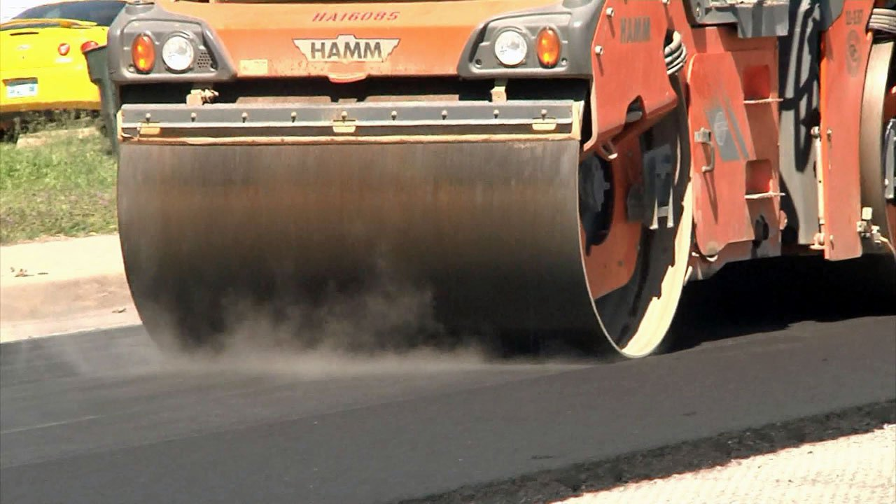 Two pockmarked Durant roads are being resurfaced. (KTEN)