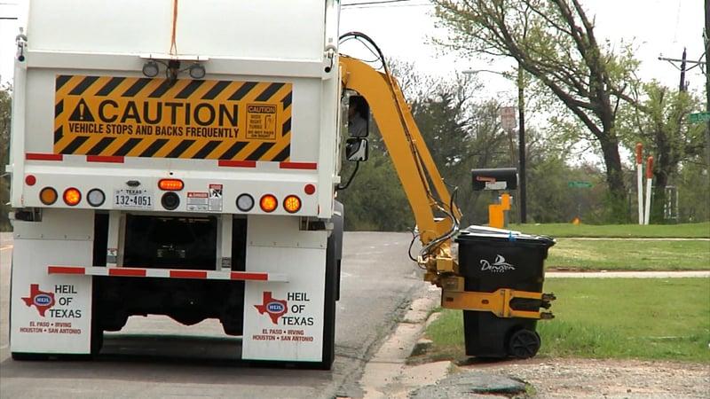 Denison's new trash trucks use a hydraulic arm to empty curbside bins. (KTEN)