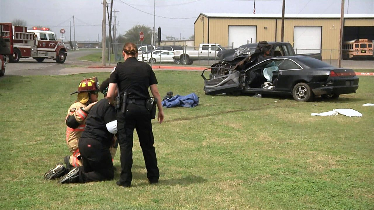"""Emergency personnel restrain a """"loved one"""" at the Shattered Dreams assembly at Whitewright High School. (KTEN)"""