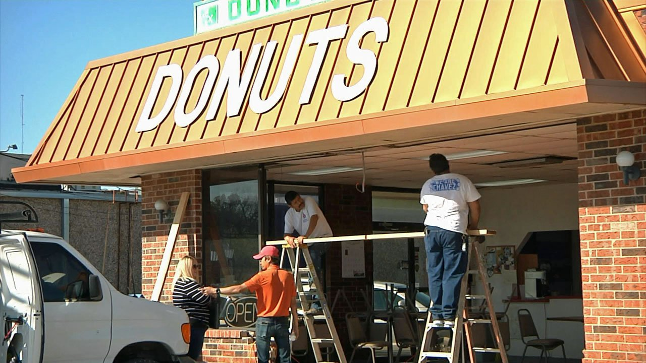 A car smashed through the front of the Southern Maid Donuts shop in Sherman on April 9, 2019. (KTEN)