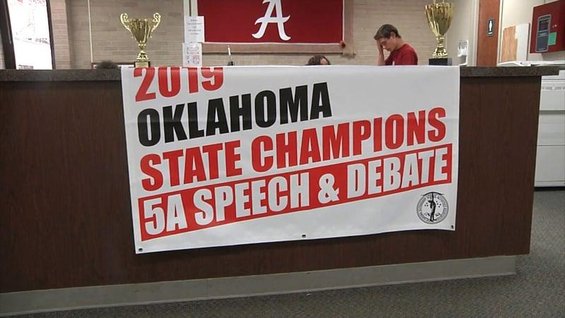 A sign recognizes Ardmore High's speech and debate team. (KTEN)