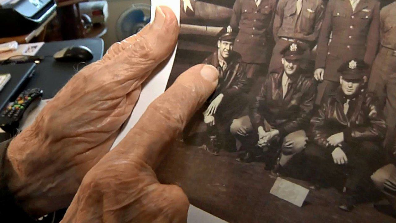 Fred Seals points to himself in a World War II vintage photograph. (KTEN)