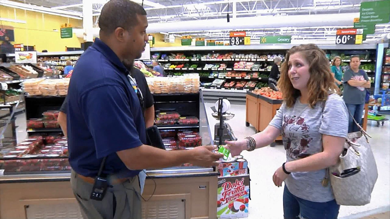Tonya Rivera accepts a gift card to help her family recover from a devastating fire. (KTEN)