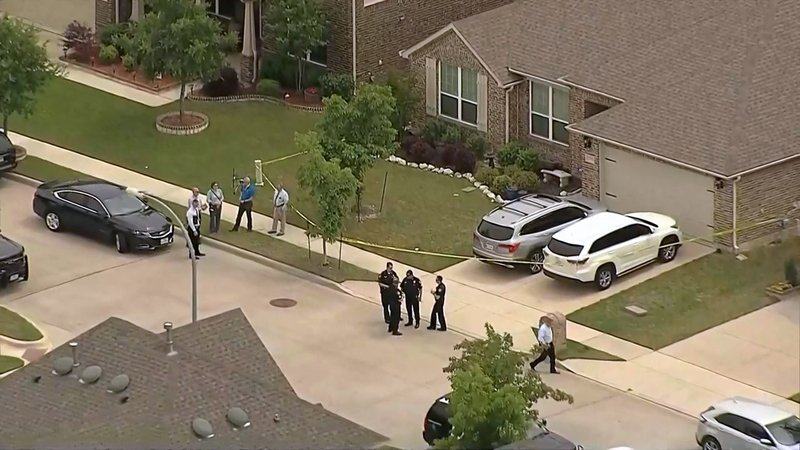 Fort Worth police investigate a residence where four bodies were found on April 22, 2019. (KXAS)