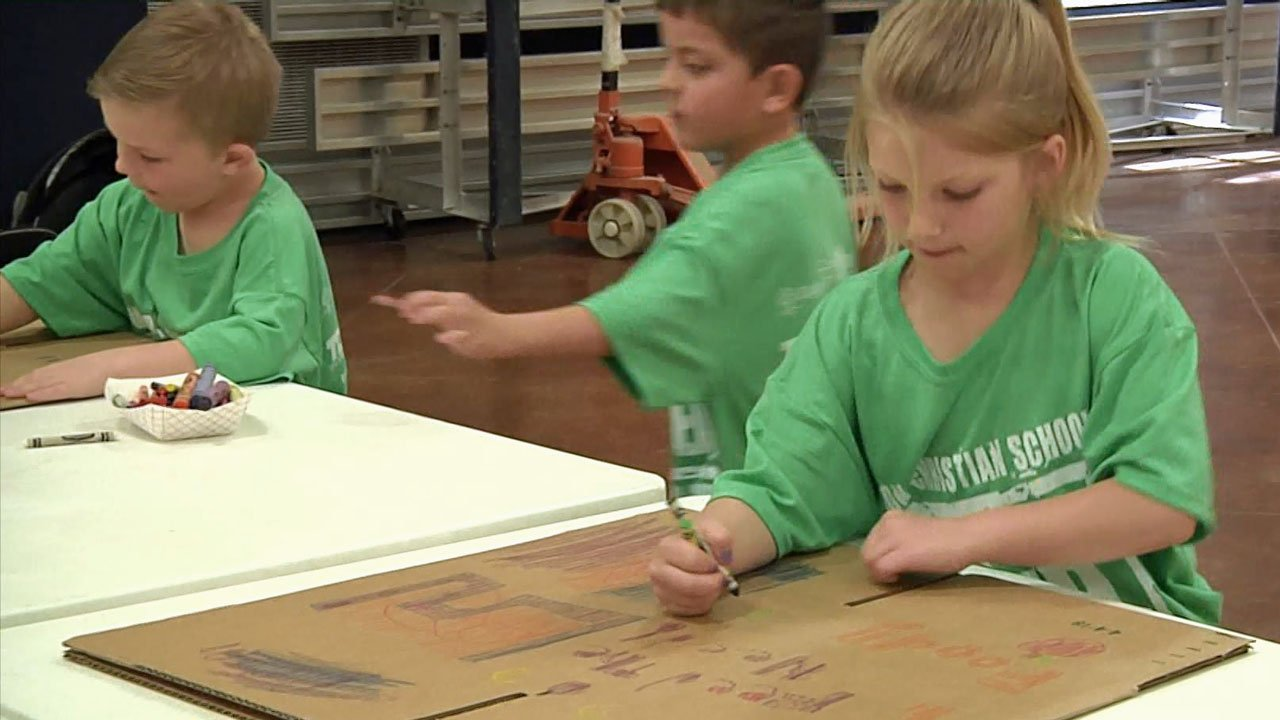 Grayson Christian School students pack food and literature bound for Haiti. (KTEN)