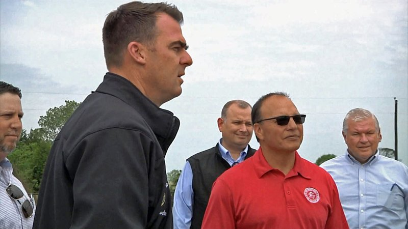Oklahoma Gov. Kevin Stitt and Choctaw Nation Chief Gary Batton review the tornado damage in Bryan County on May 6, 2019. (KTEN)