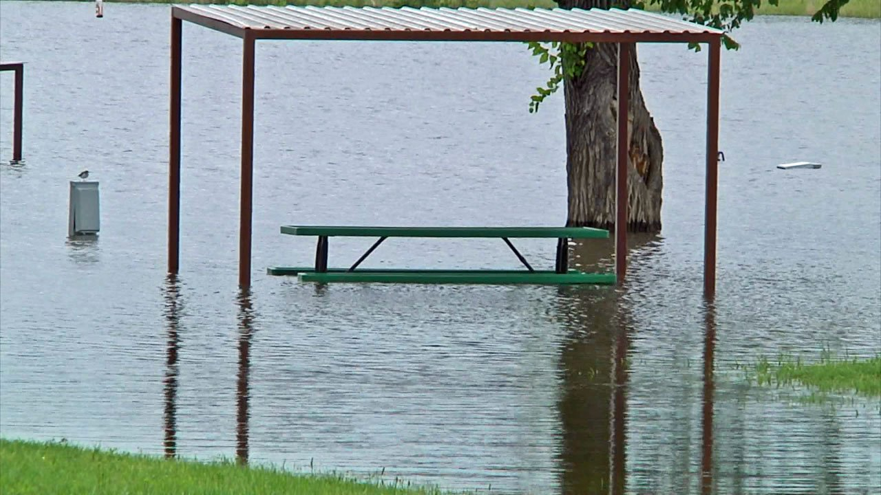 Picnic tables are under water at Lake Texoma's Burns Run West campground. (KTEN)