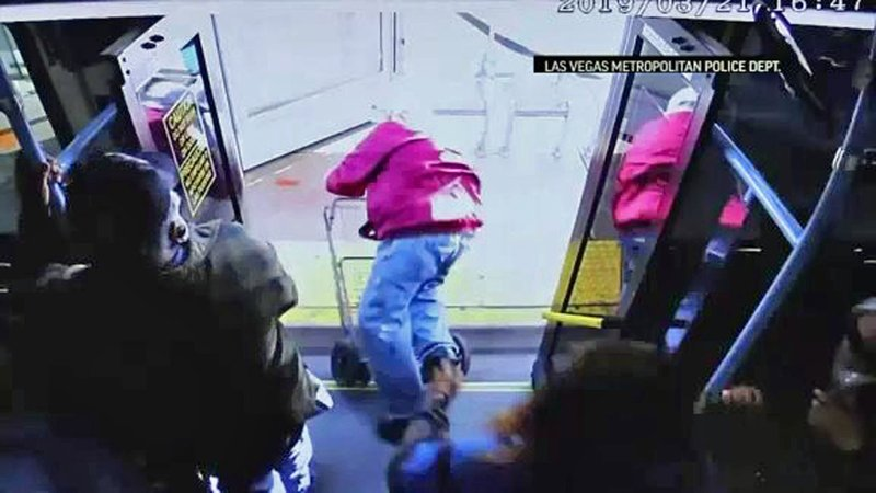 Surveillance video shows a 74-year-old man being pushed from a bus in Las Vegas on March 21, 2019. He later died. (Las Vegas Metropolitan Police)