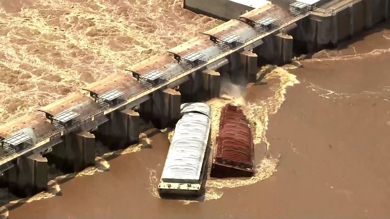 Two barges struck the Webbers Falls Dam on May 23, 2019. (KFOR via NBC News)