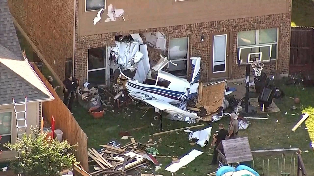 Two people were injured when their small plane crashed into a McKinney house on May 23, 2019. (KXAS via NBC News)