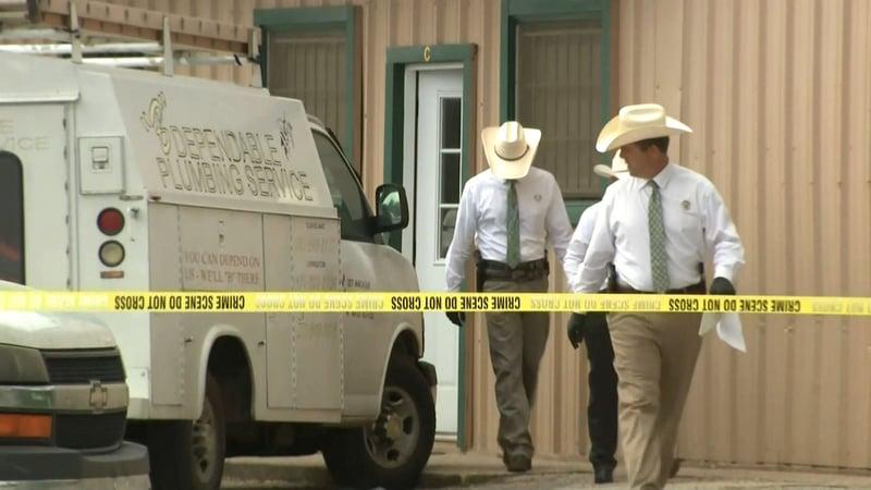 Texas Rangers gather evidence at a veterinary clinic near Cleveland, Texas, after a fatal shooting. (KPRC via NBC News)