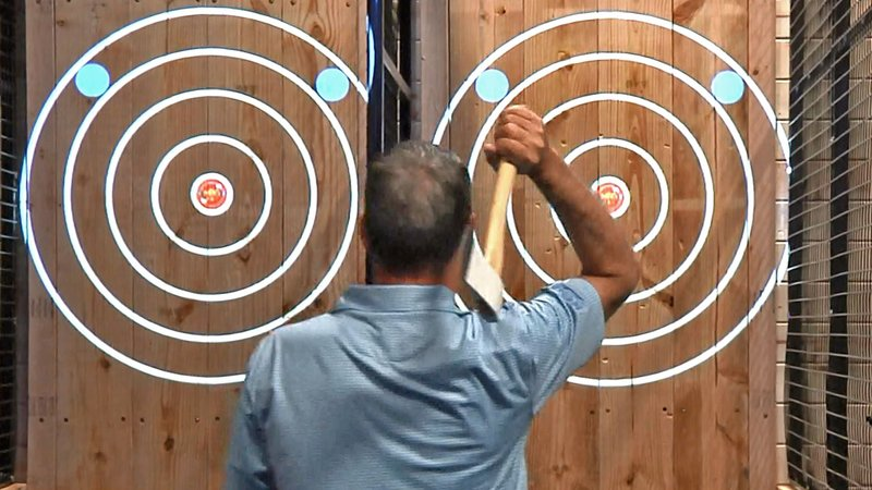 Axe-throwing is a thing at the new Schulman's Movie Bowl Grille in Sherman. (KTEN)