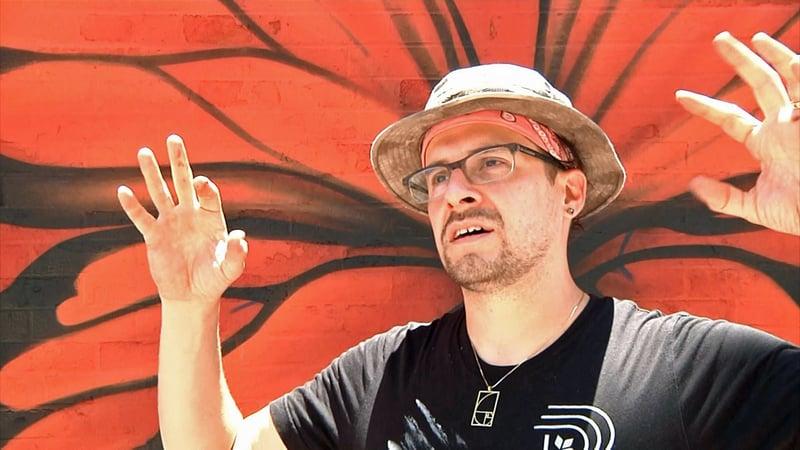 "Jerod ""DTOX"" Davies said he wants to help ""make Texas the mural capital of the world."" (KTEN)"