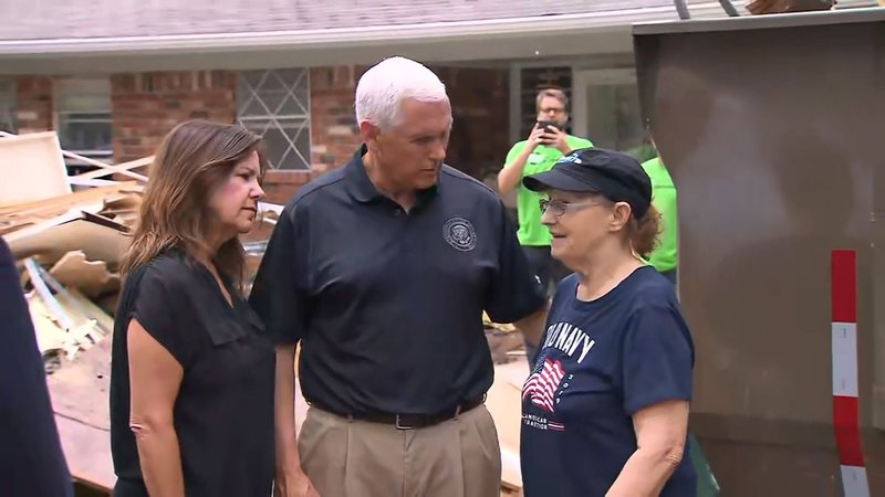 Vice President Pence and wife Karen, left, speak with a flooding victim in Tulsa. (CNN/Pool)