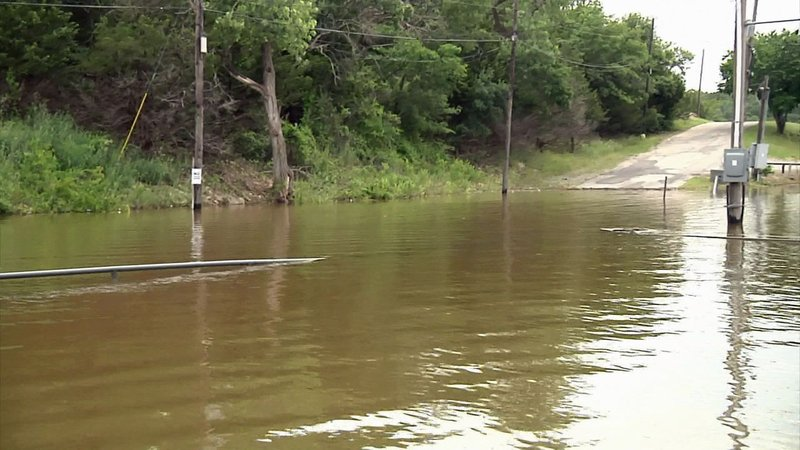 Some roads and parking areas at Highport Marina are under water. (KTEN)