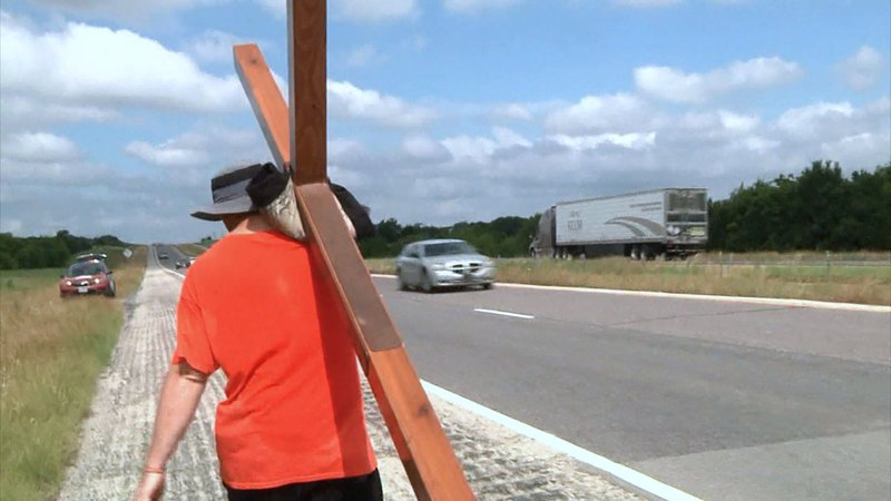 Acie Burleson was carrying his cross down US 82 in Grayson County on June 5, 2019. (KTEN)