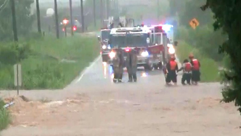 A person is rescued from floodwaters in the Oklahoma City area on June 6, 2019. (KFOR via CNN)