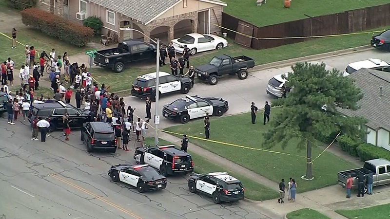 Protesters surrounded the scene of a police shooting in Fort Worth on June 9, 2019. (KTVT via CNN)