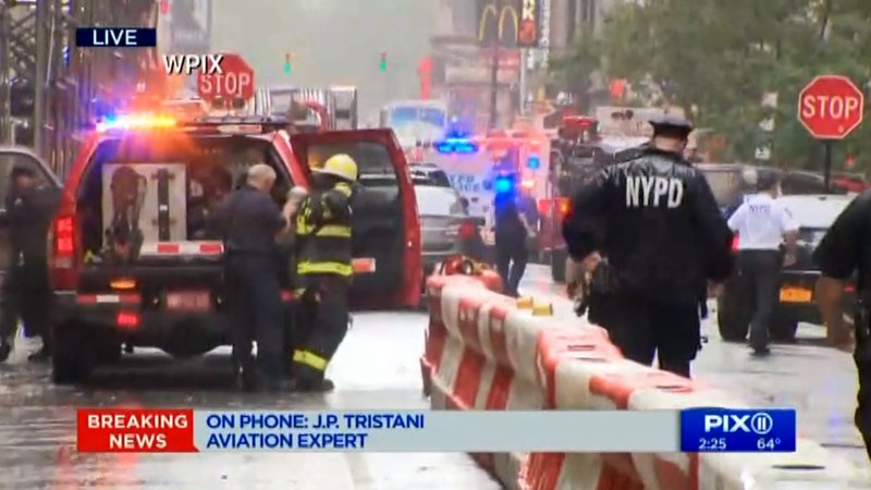 Emergency personnel near the scene of a helicopter emergency in Midtown Manhattan on June 10, 2019.  (WPIX via CNN)