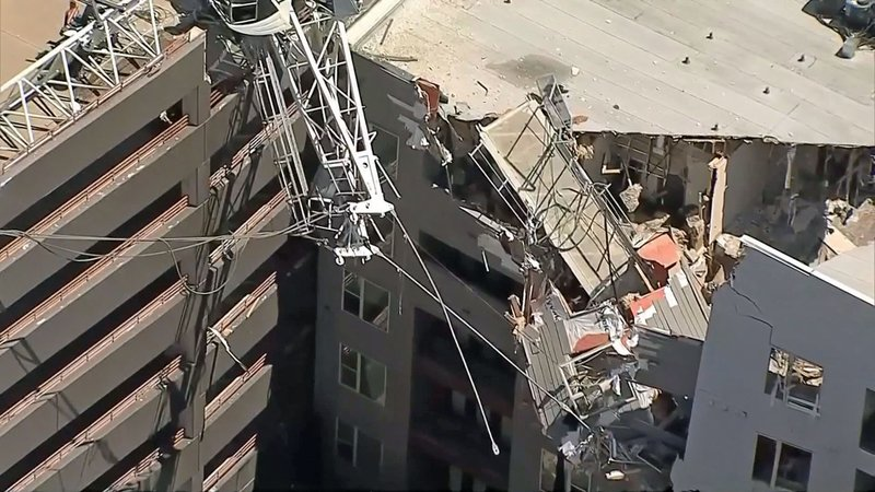 The boom of a large crane fell on a Dallas apartment building on June 9, 2019. (KXAS via NBC News)