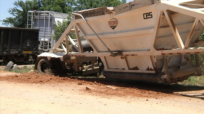 A freight train hit a truck trailer at a crossing near Mead, Oklahoma, on June 13, 2019. (KTEN)