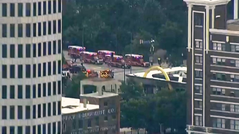 Multiple ambulances were on standby after a shooting was reported in downtown Dallas on June 17, 2019. (KXAS via NBC News)