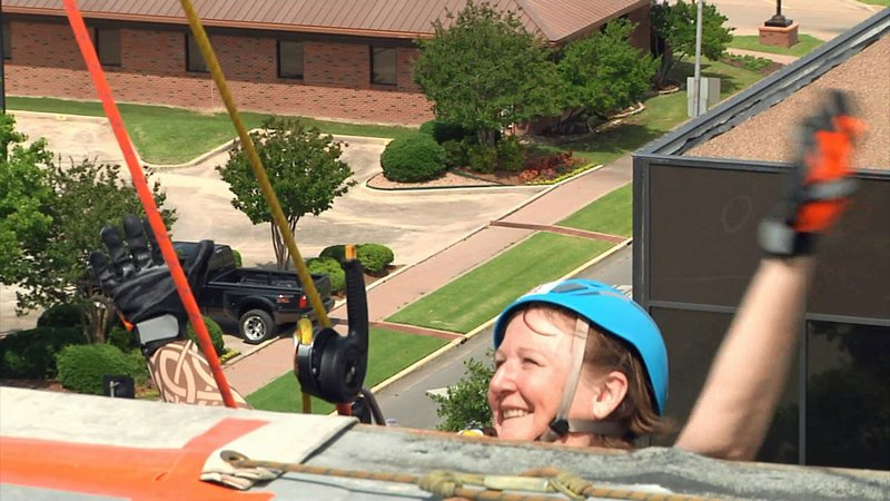 UCSO President Peggy Maher goes 'Over the Edge' at a fundraising event on June 22, 2019. (KTEN)